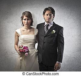 Couple marrying - Sad couple marrying