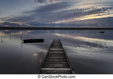 Sundown at the Jetty - The sun sets over the Fleet lagoon at...