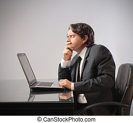 businessman doubt - businessman sitting at the table with...