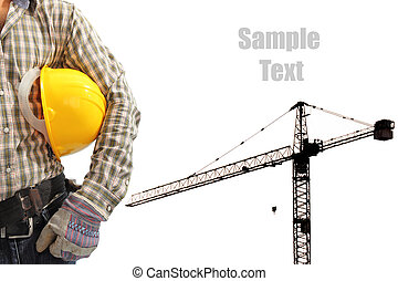 Worker and the silhouette construction tower crane in...