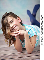 Happy young girl enjoying spare time - Happy young girl...
