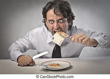 businessman eats money - Businessman eating money sitting at...
