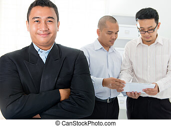 Southeast Asian business men in office
