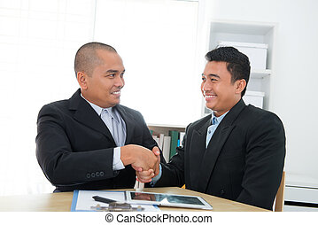 Business deal - Southeast Asian business deal in office