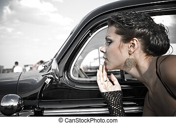 Retro beauty - Pretty girl is fixing her make-up near the...