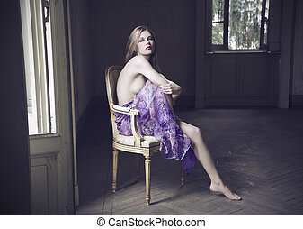 woman sitting on chair - pretty woman sitting on chair with...