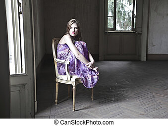 woman sitting on chair - beautiful woman sitting on chair in...