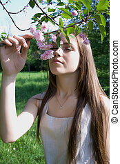 Woman enjoying spring full-blown tree - Beautiful girl...