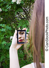 reflection of a girl in the mirror