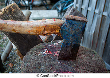 Axe of a  butcher on wood chopping board