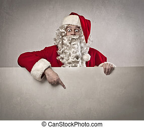 santa claus billboard - santa claus shows his finger on...