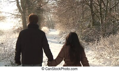 Couple Walking In Winter