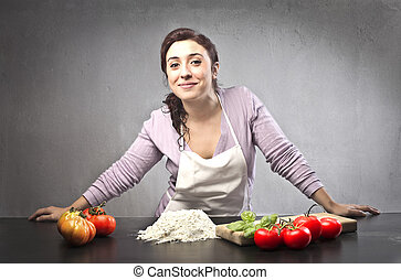 woman cooking - woman with apron cooking with flour and...