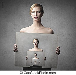 woman concept - charming woman holding a portrait of her...