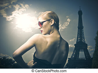 woman with Eiffel tower - elegant woman with sunglasses in...