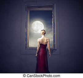 woman moon - beautiful woman looks at the moon through the...