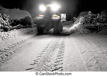 Tractor clearing snow - Heavy vehicle in blurred motion...