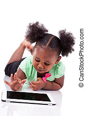 Little african american girl using a tablet pc - Little...