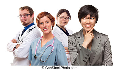 Young Mixed Race Woman with Doctors and Nurses Behind