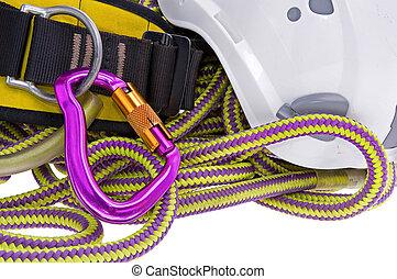 rock climbing equipment including rope, carabiner, helmet...