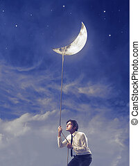 man with the moon - man holds the moon