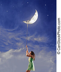 woman with the moon - woman holds the moon