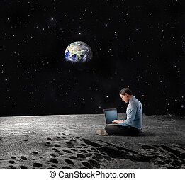 work under the moon - man working with the laptop under the...