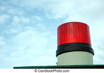 siren lights - a red siren lights with blue sky background