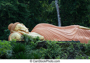 sleeping buddha statue at krabi, thailand - sleeping buddha...