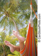 Woman in a Hammock - Woman in a hammock on a tropical beach