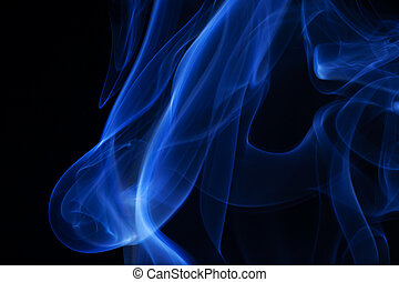 Real blue smoke over black background