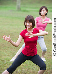 asian girls tai chi outdoor , chinese women