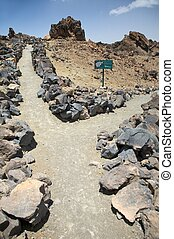 volcanic cross paths - crosspaths near teide volcano in...