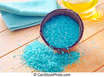 Blue sea salt on the wooden table