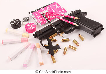 gun - A black gun with school supplies, cartridgess and a...