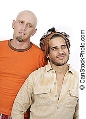 Male friends - Portrait of two casual friends standing...
