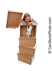 We move! - girl, cardboard boxes and a kitten on a white...