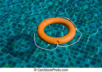 Orange Safety Lifebelt in Swimming Pool closeup
