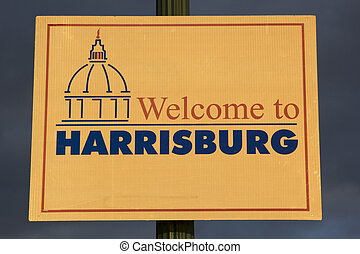 Welcome to Harrisburg sign seen during sunset