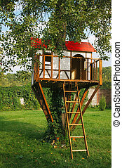 Cute small tree house for kids on backyard German style