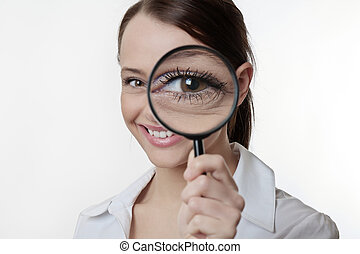 get a better look - Confident young woman looking through a...