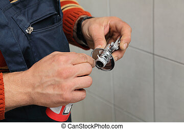 Plumbing - Plumber putting teflon wire for sealing of thread...
