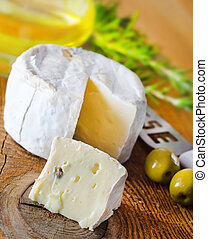 Italian cheese with olives and rosemary
