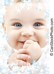 baby with snowflakes - bright closeup portrait of adorable...