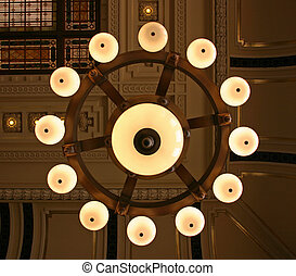 Chandelier - A chandelier on the ceiling of the train...