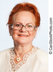 retired woman expressing positivity - portrait of retired...