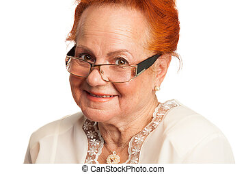 Kind old lady smiling looking through glasses isolated on...