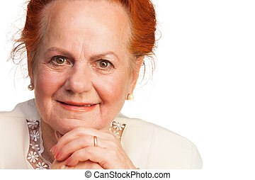 Confident senior woman smiling - Closeup of confident senior...