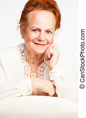 Happy retirement - Smiling senior lady with red hair...