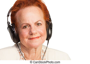 Positive senior in headphones isolated on white